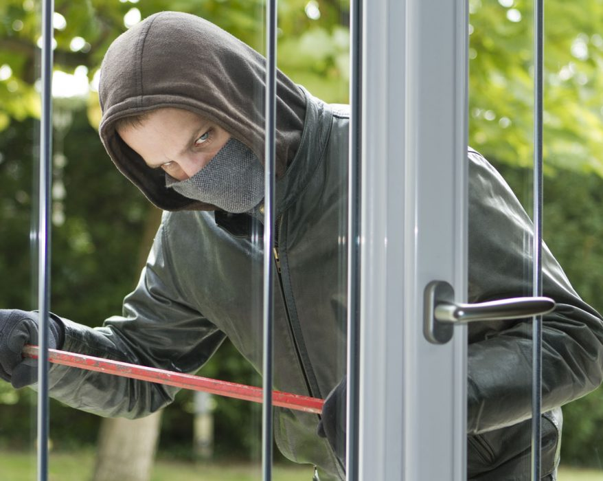 burglar-trying-to-enter-a-house