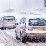Cars driving in the winter with severe weather conditions