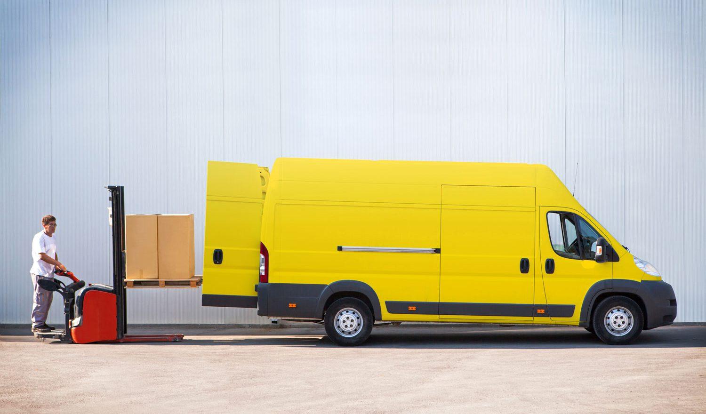 Courier-van-employee-with-packages-in-the-van