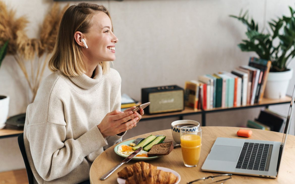 woman-enjoying-her-breakfast-at-home-while-speaking-on-the-phone-home-insurance