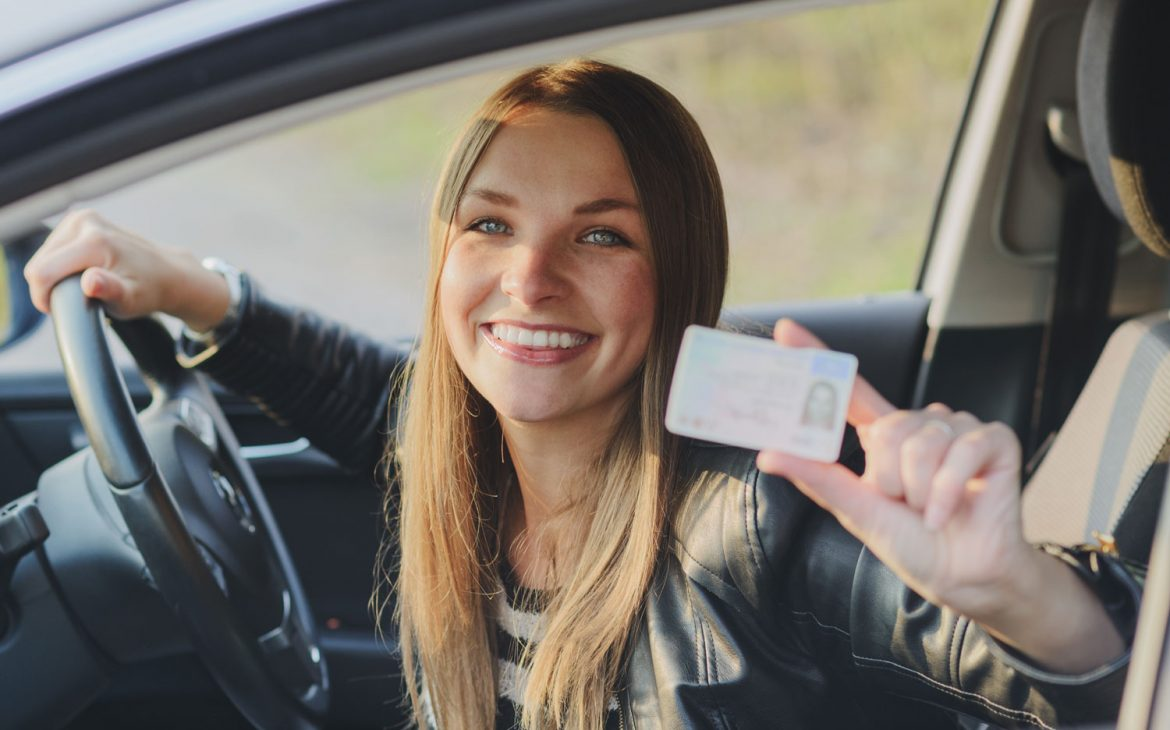 young-driver-holding-on-hand-license-DRIVEFirst